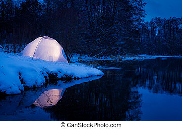 Camping in the winter at the lake