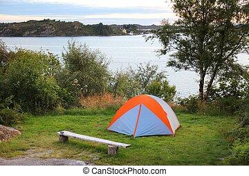 Norway camping tent. Sotra island outdoor vacation. Vestland county.