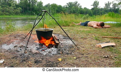 camping - kettle over campfire