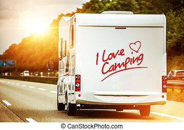 Camping Lover in the Camper Van on the Route to Summer Vacation Destination.