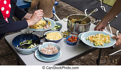 camping meal with lettuce and pasta