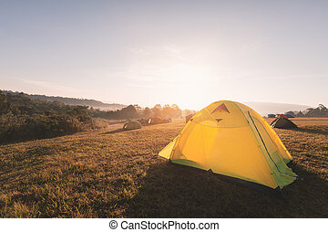 Camping on hill with warm sunlight