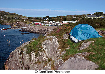 camping on the edge - a campsite on the edge of the rocks on...