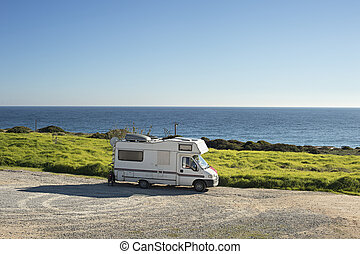 Camping on the ocean - Caravan on the beach in front of the ...
