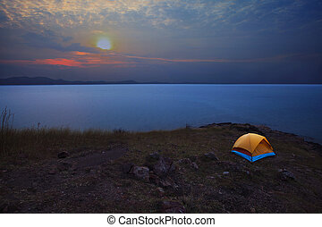 camping tent in mountain with sun r