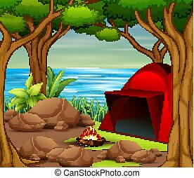 Camping tent with bonfire by the river