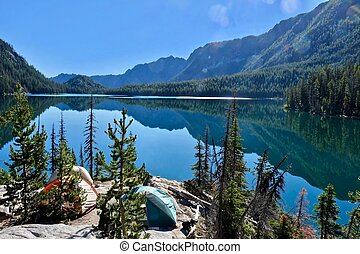 Camping tents near lake in Cascade Mountains.