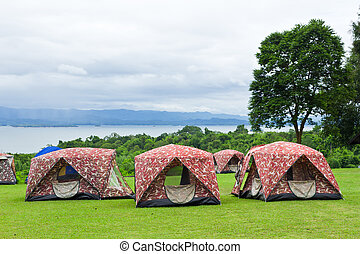 camping tents on mountain near river
