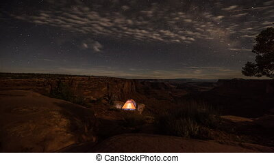 Camping under the stars Small tent on the edge of the canyon...