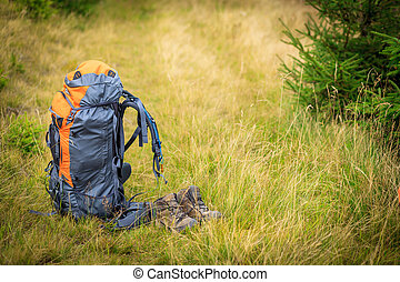 backpacks in the mountains on a sunny summer day