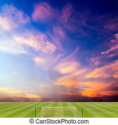 campo del fútbol, con, hermoso, ocaso, plano de fondo