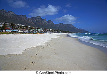 Camps Bay Beach - The Twelve Apostles mountains towering...