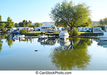 Campsite - Camping site on a lake with caravans and boats