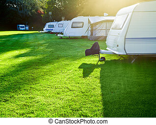 Campsite with caravans - Travel trailer camping in a morning...