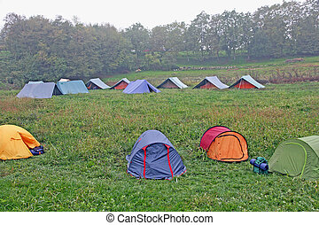 campsite with tents of boy scouts on a cold winter day - big...