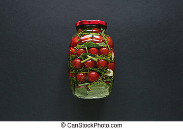 Can of tomatoes for the winter on a black background