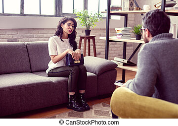 Nice attractive woman looking at her therapist