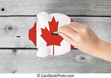 canadá, poco, concepto, ahorro, canadiense, mano, bandera, goteante, cerdito, moneda, overlaid, banco
