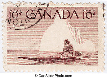 CANADA - CIRCA 1955 : stamp printed in the Canada shows Native Indian in canoe, circa 1955