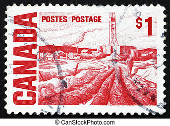 CANADA - CIRCA 1967: a stamp printed in the Canada shows Oilfield near Edmonton, Painting by H. G. Glyde, circa 1967