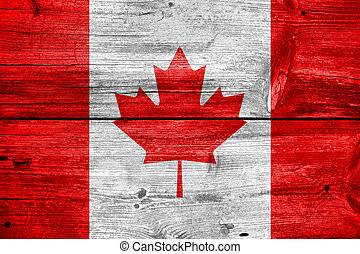 Canada Flag - Canada flag painted on old wood plank...