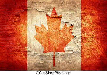 Canada flag painted on old wooden background