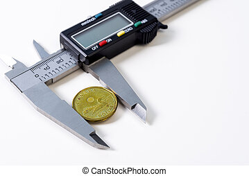 Canadian coin,and  caliper