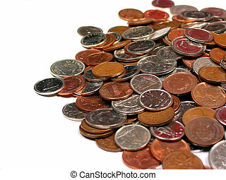 Pile of canadian coins on white background, macro, focus on the central part of the pile