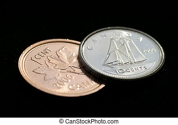 Canadian Dime&Penny - Reflective angled closeup of a the ...
