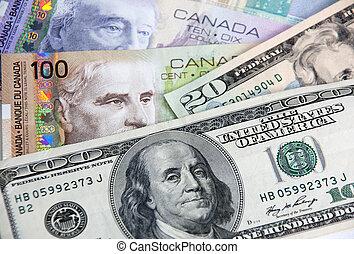 Canadian Dollars vs US dollars in close-up shot