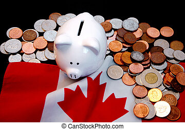 Canadian economy 2 - Piggy bank and gold coins against ...