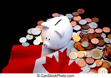 Canadian economy 4 - Piggy bank and gold coins against...