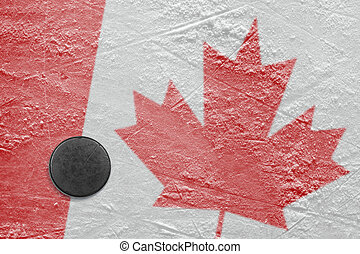 Canadian flag and the puck on the ice - Puck and a Canadian...
