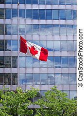 Canadian flag flies at half mast in front of government building