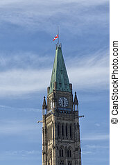 Canadian flag flies at half mast on the Peace Tower of the Parliament buildings. Ottawa, Ontario. Canada.