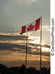 canadian flag in the sky