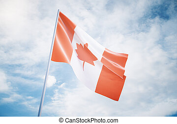 Canadian flag on sky background