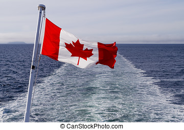Canadian Flag - Canadian flag blowing in the wind against...