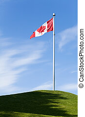 Canadian Flag and blue sky for background