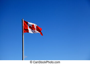 canadian flag against blue sky