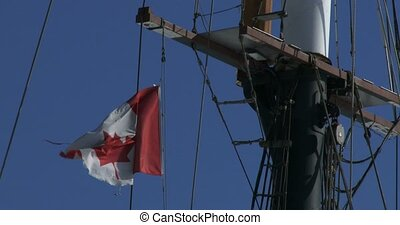 Canadian flag waving on a boat