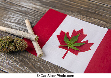 Canadian flag with assorted marijuana products - medical marijuana concept background