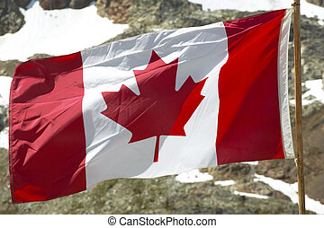 Canadian flag with mountain background. British Columbia. ...