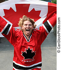 Canada Day - Canadian man flying the flag for Canada Day on ...