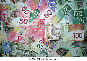 A background of canadian money with all high priced bills