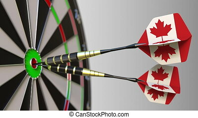 Canadian national achievement. Flags of Canada on darts hitting bullseye. Conceptual 3D animation