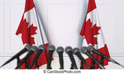 Canadian official press conference. Flags of Canada and...