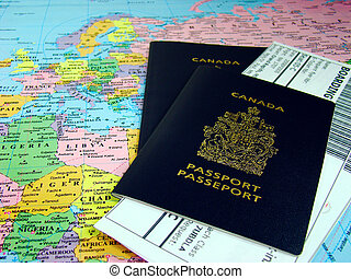 Canadian passports and boarding passes against map of the ...
