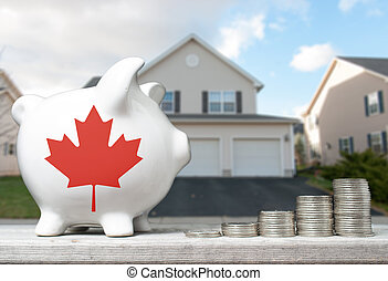 Canadian real estate investment concept with piggy bank, stacks of coins and house in the background