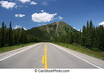 Canadian Rockies - Straight road in Rocky Mountains. ...